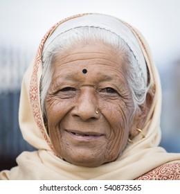 KATHMANDU, NEPAL - OCTOBER 05, 2016 : Portrait old women in traditional dress in street Kathmandu, Nepal