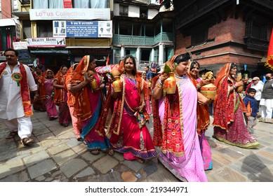 KATHMANDU, NEPAL - OCTOBER 11: Crowd of Hindu people celebrating the first day of the Dasain festival on the streets of Kathmandu. On October 11, 2013 in Kathmandu, Nepal