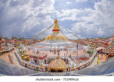 KATHMANDU, NEPAL OCTOBER 15, 2017: A front view of Boudhanath Stupa building at outdoors, with some buildings in the horizont in Kathmandu, Nepal