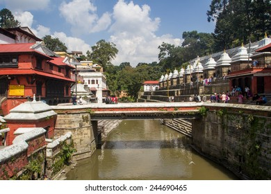 KATHMANDU, NEPAL- October 17, 2014- Crowds tour the Pashupatinath temple complex, a Hindu holy site and major attraction for pilgrims and tourists.