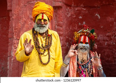 Kathmandu, Nepal - October, 20, 2018: Two Sadhu holy men in traditional clothes in Pashupatinath Temple in Kathmandu, Nepal