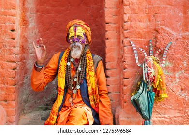 Kathmandu, Nepal - October, 20, 2018: Sadhu holy man in traditional clothes in Pashupatinath Temple in Kathmandu, Nepal