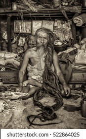 KATHMANDU, NEPAL - OCTOBER 21, 2015 : Shaiva sadhu (holy man) with traditional long hair living in Pashupatinath Temple