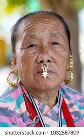 KATHMANDU, NEPAL - OCTOBER 23, 2016 : Portrait old women in traditional dress in street Kathmandu, Nepal
