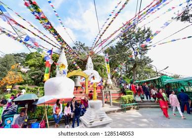 Kathmandu, Nepal - October 23, 2018: White Nepali Stupa with Buddha's Wisdom Eyes Near Swayambhunath Stupa