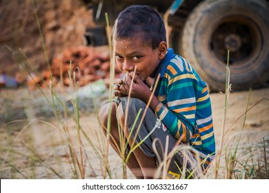 KATHMANDU, NEPAL - OCTOBER 31, 2017: The nepalese boy looks into the camera.
