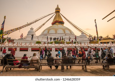 Kathmandu, Nepal : October-17-2018 : Tibetan and Nepali people walking and praying around the base of Boudhanath Stupa the largest stupas in the world located in Kathmandu the capital city of Nepal.