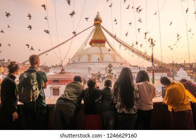 Kathmandu, Nepal : October-17-2018 : Tourist looking to beautiful view of Boudhanath Stupa the largest stupas in the world located in Kathmandu the capital city of Nepal at sunset.
