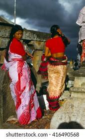 KATHMANDU, NEPAL - SEP 20, 1979 - Nepali women at Swyambudnath Temple, with oncoming thunderstorm,