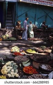 KATHMANDU, NEPAL - SEP 20, 1979 - Men meet in the vegetable market in Kathmandu, Nepal, Asia