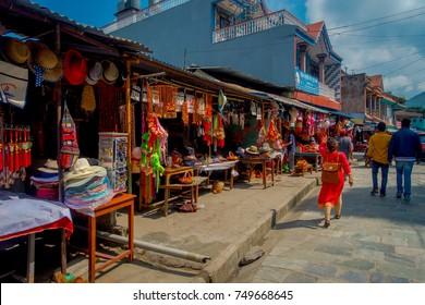 KATHMANDU, NEPAL - SEPTEMBER 04, 2017: Unidentified people walking in the morning market in Kathmandu, Nepal. The morning market is located near Annapurna temple at the center of Kathmandu, Nepal