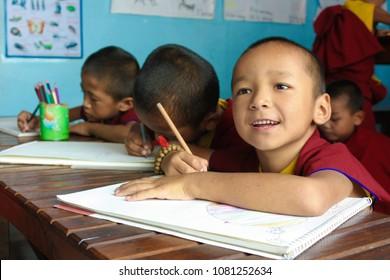 KATHMANDU, NEPAL - September 10, 2017 - Children Buddhist monks learning and studying drawing in classroom at Tibetan monastery in Kathmandu, Nepal.