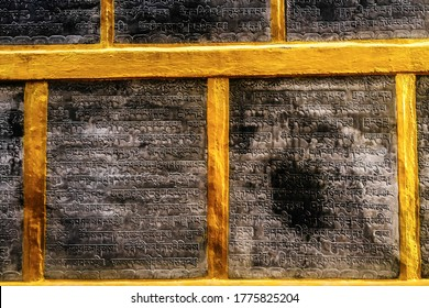 Kathmandu, Nepal - September 20, 2018: An ancient Buddhist text in Sanskrit etched into temple in Kathmandu ,with a Sanskrit writing