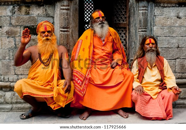 KATHMANDU, NEPAL - SEPTEMBER 21: Holy Sadhu men with traditional painted face, blessing in Pashupatinath Temple. September 21, 2012 in Nepal, Kathmandu.