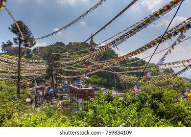 KATHMANDU, NEPAL - September 23, 2013: Swayambhunath stupa, an ancient religious architecture atop a hill in the Kathmandu Valley, west of Kathmandu city.  Kathmandu is the largest metropolis in Nepal