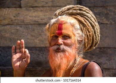 KATHMANDU, NEPAL - SEPTEMBER 25, 2016 : Portrait Sadhu at Pashupatinath Temple in Nepal. Sadhu is a holy man, who have chosen to live an ascetic life and focus on the spiritual practice of Hinduism.