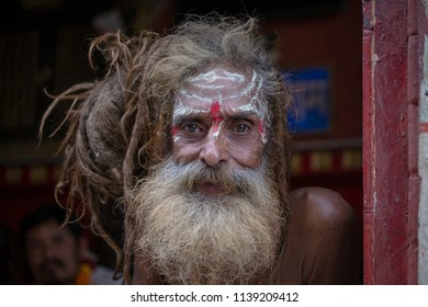 KATHMANDU, NEPAL - SEPTEMBER 29, 2016 : Portrait Sadhu at Pashupatinath Temple in Nepal. Sadhu is a holy man, who have chosen to live an ascetic life and focus on the spiritual practice of Hinduism