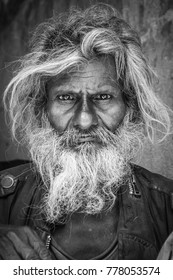 Kathmandu, Nepal- September 9 2017:Black and white portrait of a bearded man in the streets of Kathamandu.