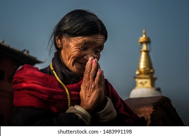 Kathmandu, Nepal,12-12-0218, An old Tibetan woman travels to pay respect to a temple in Nepal.