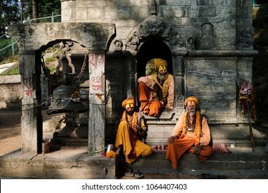KATHMANDU, NEPAL-MARCH 23, 2017: Holy men posing near Pashupatinath Temple, 23 March 2017