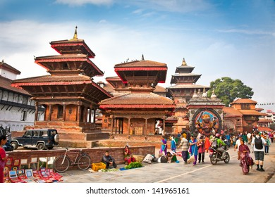 KATHMANDU, NEPAL-MAY 19: Crowd of local Nepalese people visit the famous Durbar square on May 19, 2013 in Kathmandu, Nepal. Bhaktapur is the third largest city in Kathmandu valley