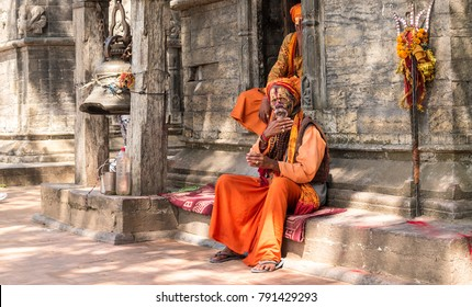KATHMANDU, - OCTOBER 05: Nepal, Kathmandu. Sadhu holy men in front of Pashupatinath temple in Kathmandu, Nepal, October 05, 2017