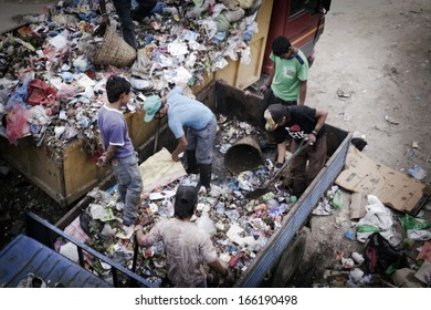 KATHMANDU - OCTOBER 2: People working on garbage truck taken in Kathmandu on October 2, 2013 in Kathmandu, Nepal.