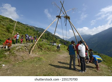 KATHMANDU - OCTOBER 4: people play on a traditional bamboo 'ping' swing constructed for the Dashain festival to celebrate the end of the rainy season on October 4, 2014 in Kathmandu, Nepal.