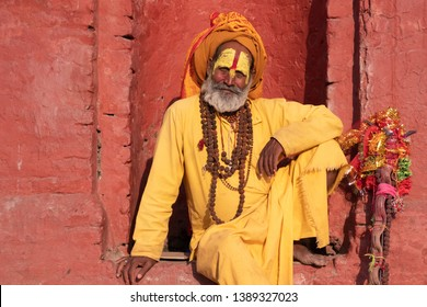Kathmandu Sadhu men holy person in hinduism with traditional painted face at Pashupatinath Temple of Kathmandu - Non English word in image is prayer words