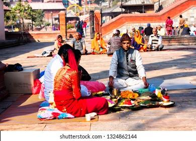 KATHMANDU, TEMPLE - DEC 10, 2018: People pray at Pasupatinath temple in Kathmandu