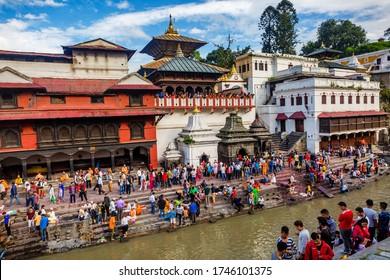 Kathmandu,Nepal - August 14,2019: Crowd of Hindu Prayers during Janai Purnima Rakshya Bandhan Festival in Pashupatinath Temple Premises,KKathmandu.