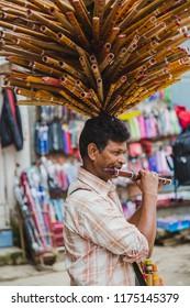 Kathmandu,Nepal - Jul 22 ,2018:Nepali Flute Seller Selling playing Flute in the street of Nepal.