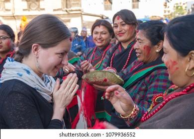 Kathmandu,Nepal - May  01,2017: A Tourist with Nepali women in Patan Kathmandu during Rato Machindranath Jatra Festival.