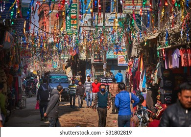 KATHMANDU/NEPAL - NOVEMBER 25, 2016: Busy shopping street with colorful decorations in Thamel district of Kathmandu, Nepal