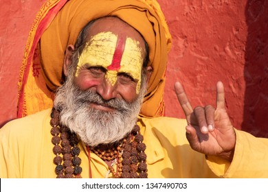 Kathmandu,Nepal - OCT 18 2018 Unidentified Sadhu men with traditional painted face in Pashupatinath Temple of Kathmandu, Nepal.Sadhu men refer to holy person in Hinduism