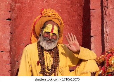 """Kathmandu,Nepal Sadhu man with traditional painted face in Pashupatinath Temple.Non english word meaning """"Om mani padme hum""""an ancient Buddhist mantra"""