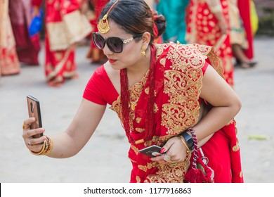 Kathmandu,Nepal - Sep 12,2018: Hindu Nepali Women celebrating Teej Festival in Kathmandu.Hindu Nepali Women fast and wish for a prosperous life of their spouse and family on this festival.