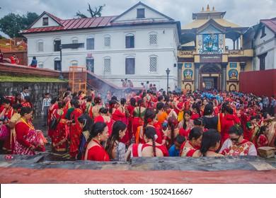 Kathmandu,Nepal - Sep 2,2019 : Crowd of Nepali Women at Pashupatinath Temple during Teej Festival in Kathmandu. During Teej,Hindu women fast & pray for their husband's good health and long life.