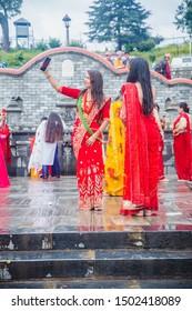 Kathmandu,Nepal - Sep 2,2019 : Nepali Women taking selfie at Pashupatinath temple during Teej Festival in Kathmandu. During Teej,Hindu women fast & pray for their husband's good health and long life.