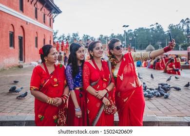 Kathmandu,Nepal - Sep 2,2019 : Nepali Women taking selfie  at Pashupatinath temple during Teej Festival in Kathmandu.During Teej,Hindu women fast & pray for their husband's good health and long life.