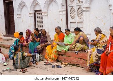 kathmandu,Nepal,9,2007;Women sitting reading and conversing