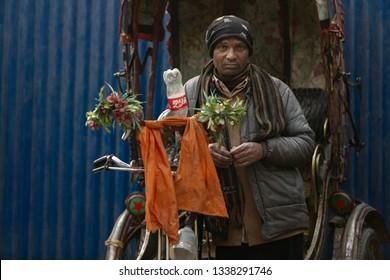Kathmandu,Nepal-January 12, 2019: Rickshaw drivers wait for customer in the streets of Patan region in Kathmandu