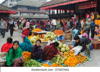 KATHMANDU,NEPAL,NOVEMBER 04,2010: Morning market activity in the Historical Patan Durbar square in Kathmandu, Nepal.
