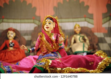 Kathputli is a string puppet theatre, naive to Rajasthan, India, and is the most popular form of Indian puppetry. it is controlled by a single string that passes from top of puppet over the puppeteers