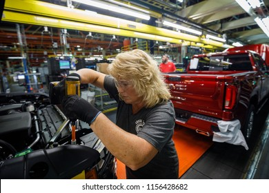 Kathy Huff installs a headlight assembly at GM's Chevrolet Silverado and GMC Sierra pickup truck plant in Fort Wayne, Indiana, U.S., July 25, 2018. Picture taken on July 25, 2018.