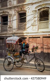 KATMANDU, NEPAL - APRIL 7, 2016 : Traditional nepalese rickshaw parked on the Thamel street with nepali driver.