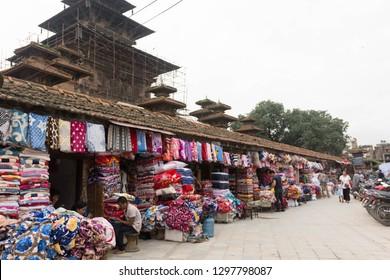 Katmandu / Nepal - August 25 2018: Local merchants selling traditional cloth in Durbar Square, Katmandu.