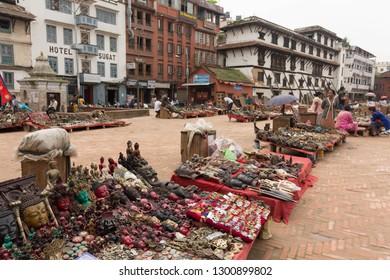 Katmandu / Nepal - August 27 2018: Merchants selling there wares in Durbar Square.