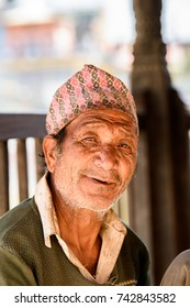 KATMANDU, NEPAL - MAR 6, 2017: Unidentified Chhetri old man in a hat smiles. Chhetris is the most populous ethnic group of Nepal