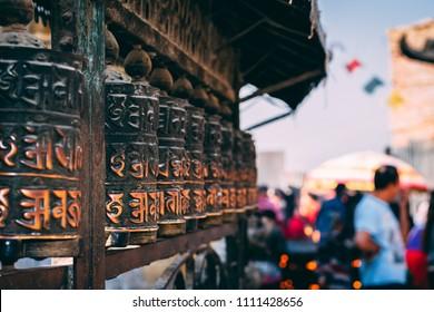 Katmandu, Nepal, March 16th 2018: Buddhist prayer wheels at the Monkey Temple in Katmandu, Nepal